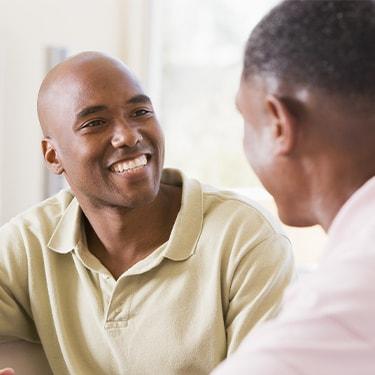 Image of man smiling.